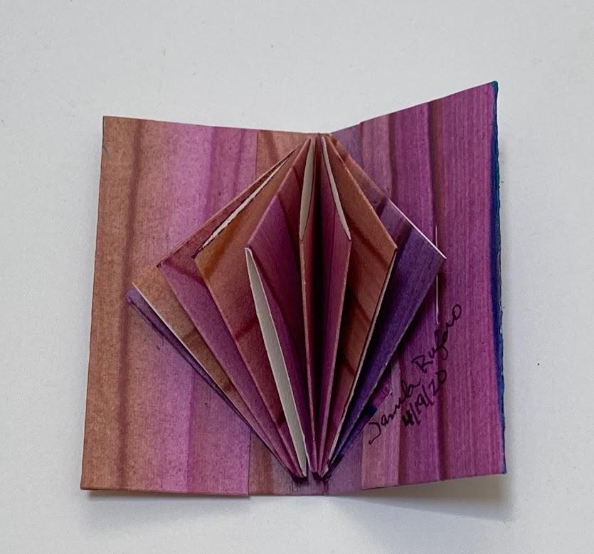 Jamila-Rufagio-triangle-fold